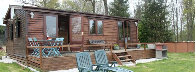 Charming 2 bed chalet overlooking it's own private lake and swimming pool - sleeps 6