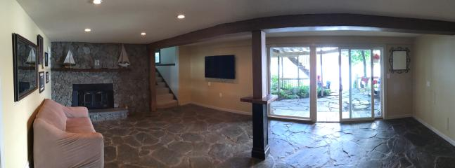 Downstairs living area 55' tv. Separate areas ideal for a large group.