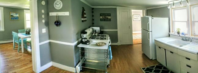 Kitchen area, looking into the dining room and the den.
