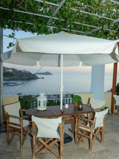 One of two private terrace with umbrella  with fantastic seaview and romantic sunsets