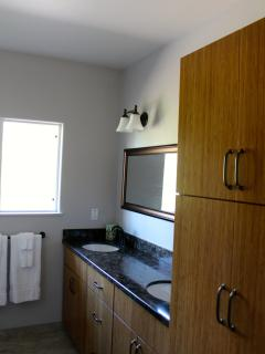 Upstairs bathroom with bamboo cabinets & quartz countertops