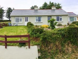 CARRIG HOUSE, detached, all ground floor, en-suite, solid fuel stove