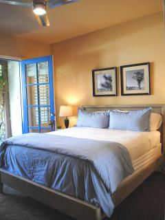 One-bedroom suite has King Bed, flat screen TV, Apple TV, Blu-Ray, and access to covered patio.