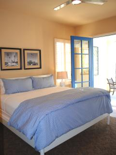 Studio bedroom has King bed,  private patio, fireplace, flat screen TV,  Apple TV, Blu-Ray, & wetbar