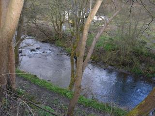 Cottage with river running at bottom of garden, Glyn Ceiriog