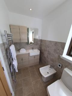 A photo of one side of the en-suite which is off the master bedroom.