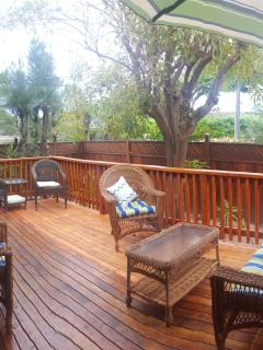 Large wood lanai with patio furniture. Great hang out place.