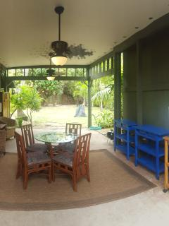 Outdoor living area with ceiling fans and beverage fridge