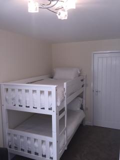 The Bunk Room has two full sized singles to cater for adults or children. Hosting a 40' Smart TV