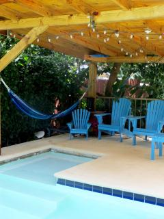 Pool + seating area and hammock