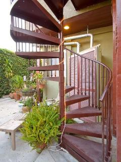 Spiral staircase from balcony to backyard