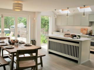 The spacious bespoke open-plan kitchen diner provides a wonderful sociable space.