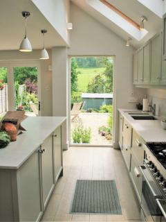 The fully equipped high-spec kitchen makes cooking a pleasure.