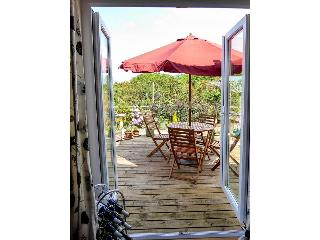 Patio doors open from the dining room into the garden