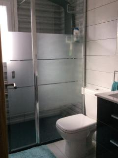 NEW Bathroom with Luxury Walk In Shower and vanity unit with mirror cabinet. Great storage.