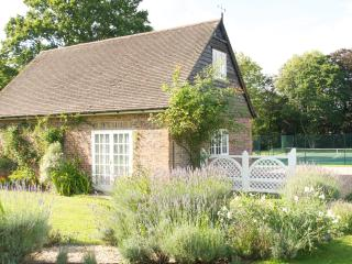 Rural coach house cottage with tennis court