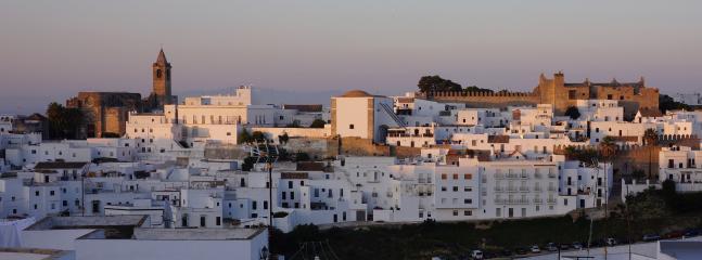 Terrace view - sun setting on the old town. su punto de vista - puesta de sol en el casco antiguo.