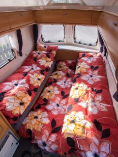 Caravan setup with three beds