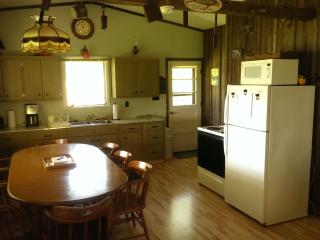 Fully furnished kitchen including toaster, coffee maker/grinder, pots, pans, dishes, Dining area.
