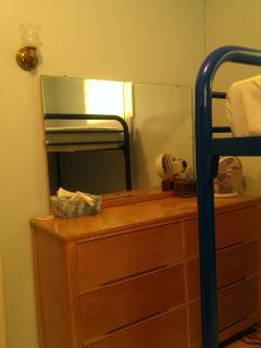 Bedroom 2 contains a dresser with mirror, two bunk beds, and standard size closet.