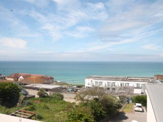 View of Fistral Beach from balcony which has seating. accessed from dining area