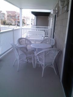 Large covered porch.  On the other side is another love seat.