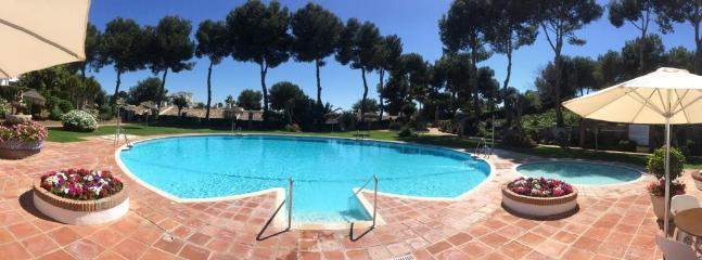 Beautiful pool and bar area just 30 metres from the apartment.