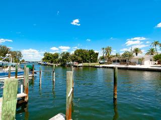 Gorgeous condo on the canal with private boat dock! A few Miles From the Beach!