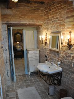 A fully modern bathroom created out of an amazing 15th century  store room.
