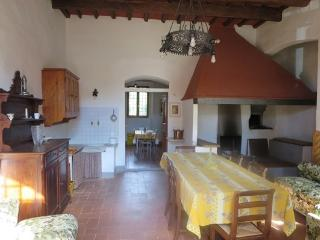 a large Tuscan country farmhouse kitchen with a huge fireplace