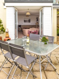 Flat patio with table and BBQ