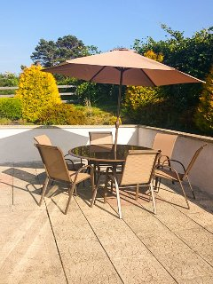 A sunny spot with comfortable furniture and bbq- perfect for dining 'al fresco'.