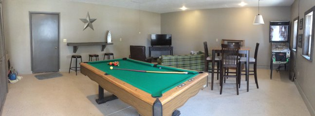 Game room with pool table, pinball, TV, and pull out sofa