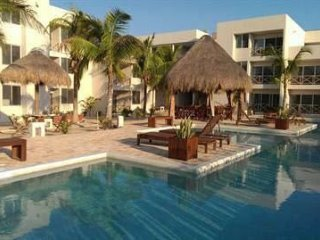 Beautiful 3 Bedroom Condo one block from the beach