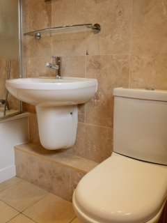 Relax in our new travertine bathroom
