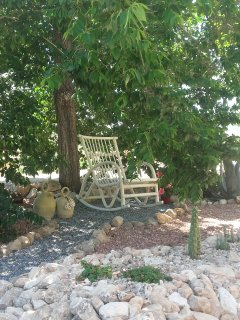 Rockingchair in a cozy shady place.
