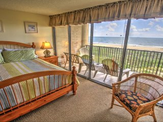 Master Bedroom with King Size Bed and Floor to Ceiling View of the Beach