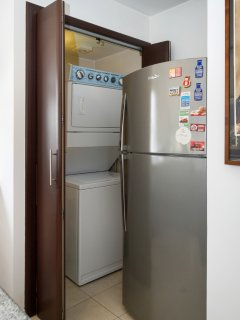 Large Fridge Freezer.  Sliding doors open behind to access washing machine & tumble dryer.