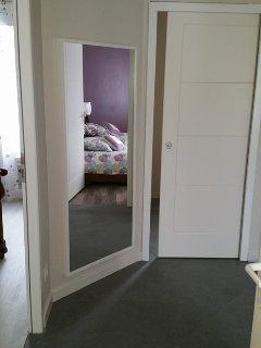 couloir desservant les chambres, les WC et la salle de bain.