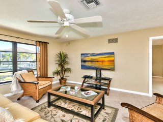 Living Room with Canal Views; Fan; Flat Screen TV; Ample Seating Perfect for a Family Movie or Game Night!