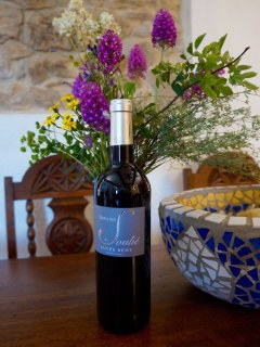 Enjoy a complimentary bottle of fine local organic wine
