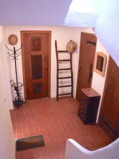 Three doors lead to utility room (washing machine as well as firewood), linen closet and bathroom