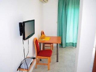 Apartmani Dalmatino-Citrus, Komarna