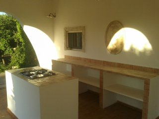 the new outdoor kitchen under the covered terrace