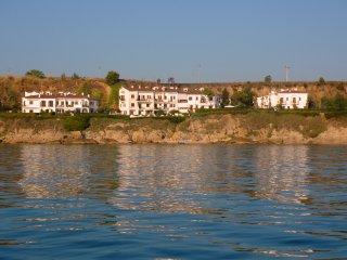 Appartamento stile mediterraneo su scogliera