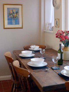 The traditional pine plank dining table seats 4