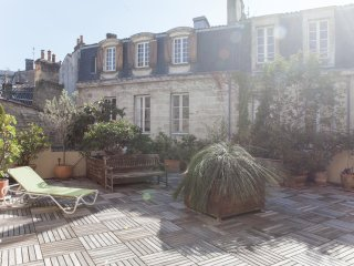 Magnifique appartement face au Jardin Public avec grande terrasse et ascenseur