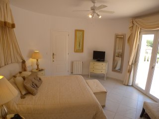 Master bedroom has double doors to its own upper terrace and TV with 30 English channels.