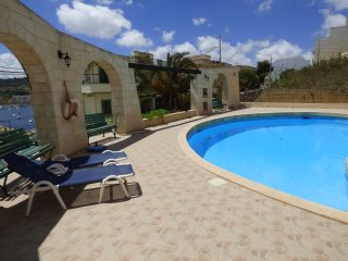 Apartment with pool - reserved parking. Enjoys fantastic view of St. Paul's Bay