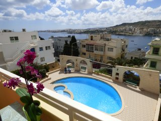 Apartment with pool - reserved parking. Enjoys fantastic view of St. Paul's Bay, Xemxija